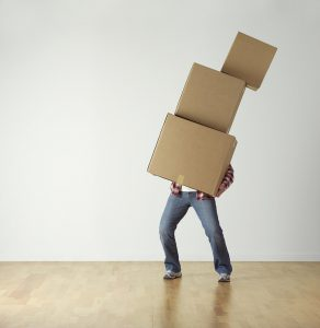 A man juggling with heavy moving boxes - This is more or less what your DIY move would look like