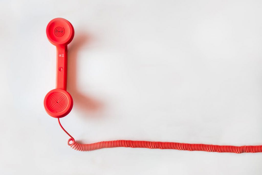 A red telephone headset