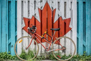 A bike in front of garage with Canadian flag.