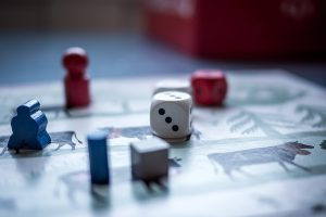 Figures and a dice on a board game